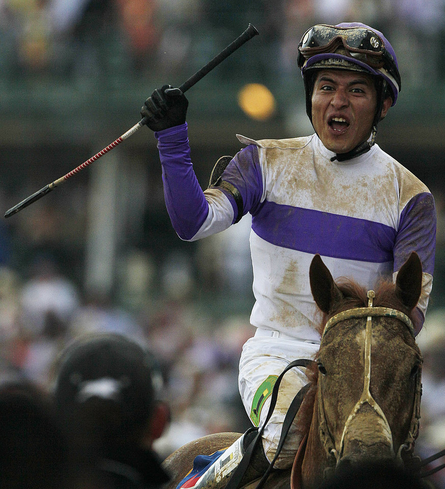Jockey Mario Gutierrez reacts after riding I'll Have Another to victory in the 138th Kentucky Derby horse race at Churchill Downs Saturday, May 5, 2012, in Louisville, Ky. (AP Photo/Mark Humphrey)  ORG XMIT: DBY222