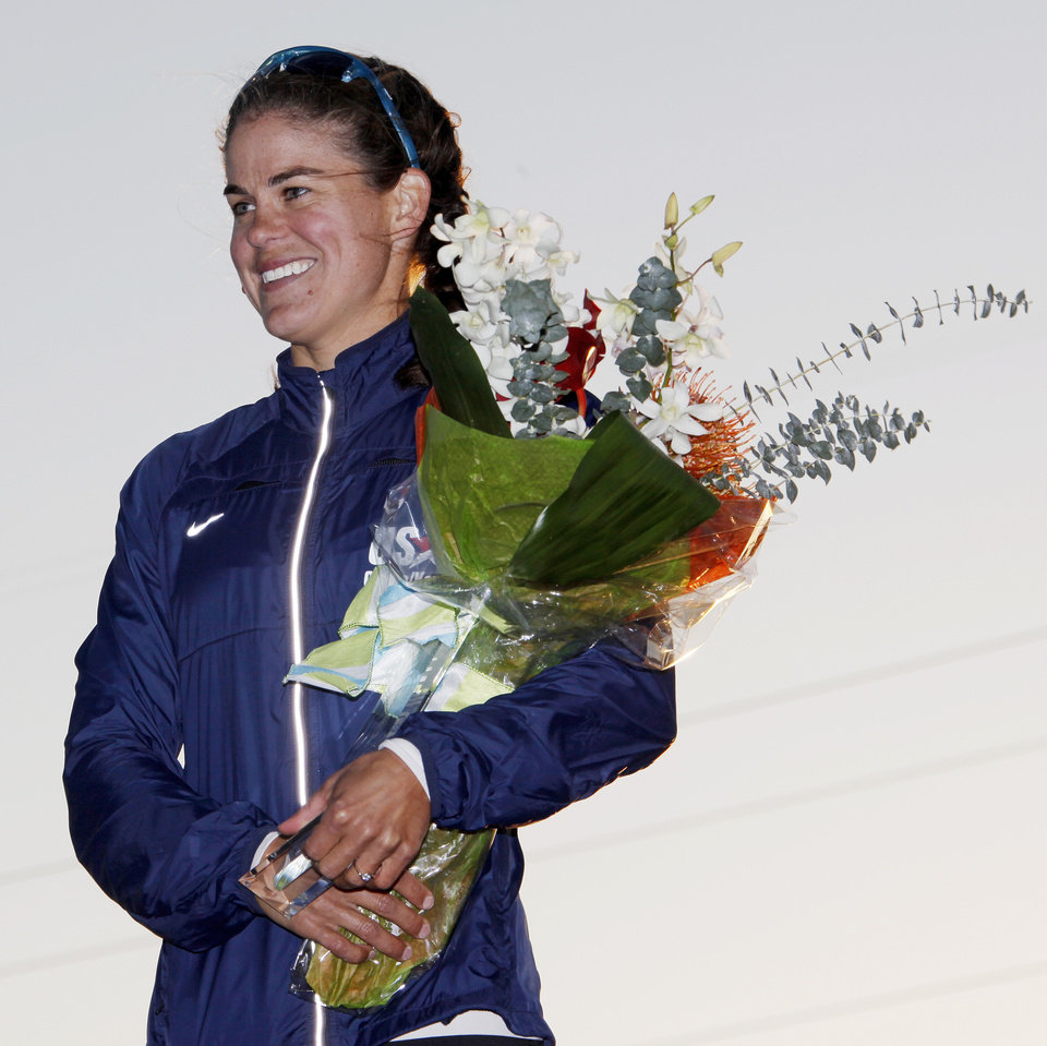 Photo - Carrie Johnson smiles on the awards stand after winning the women's kayak 500m final to qualify for the Olympic team, during the USA Canoe/Kayak U.S. Olympic Team Trials on the Oklahoma River in Oklahoma City, Friday, April 20, 2012. Photo by Nate Billings, The Oklahoman