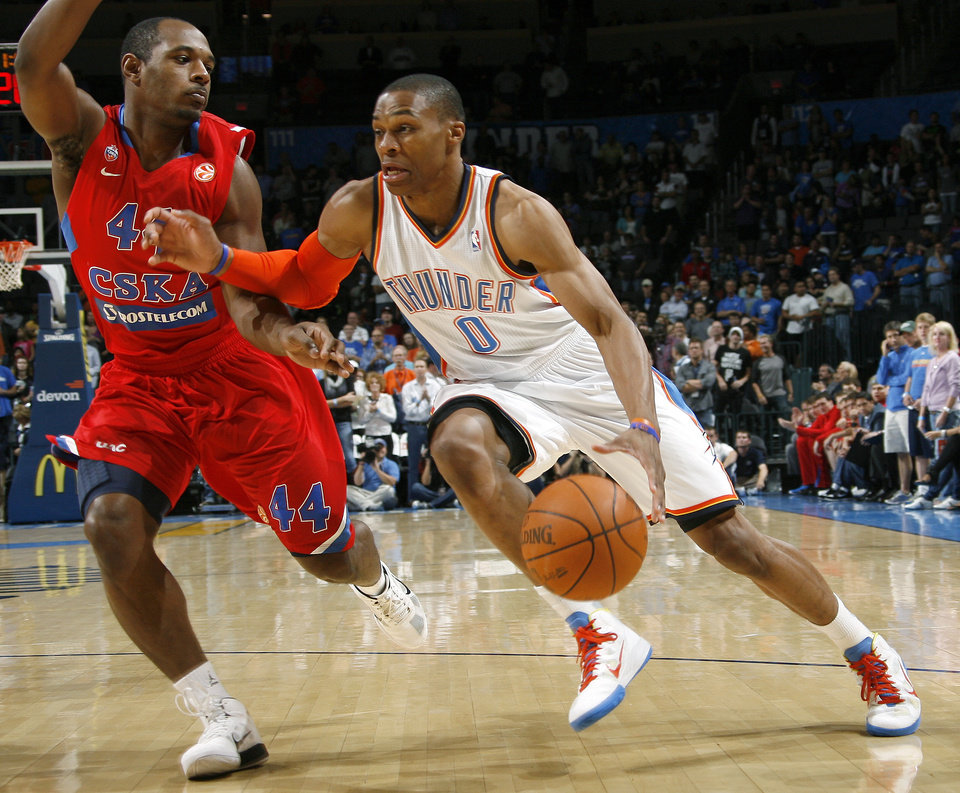 Oklahoma City's Russell Westbrook (0) drives past CSKA Moscow's Jamont Gordon (44) during the preseason NBA basketball game between the Oklahoma City Thunder an CSKA Moscow in Oklahoma City, Thursday, October 14, 2010. Photo by Bryan Terry, The Oklahoman