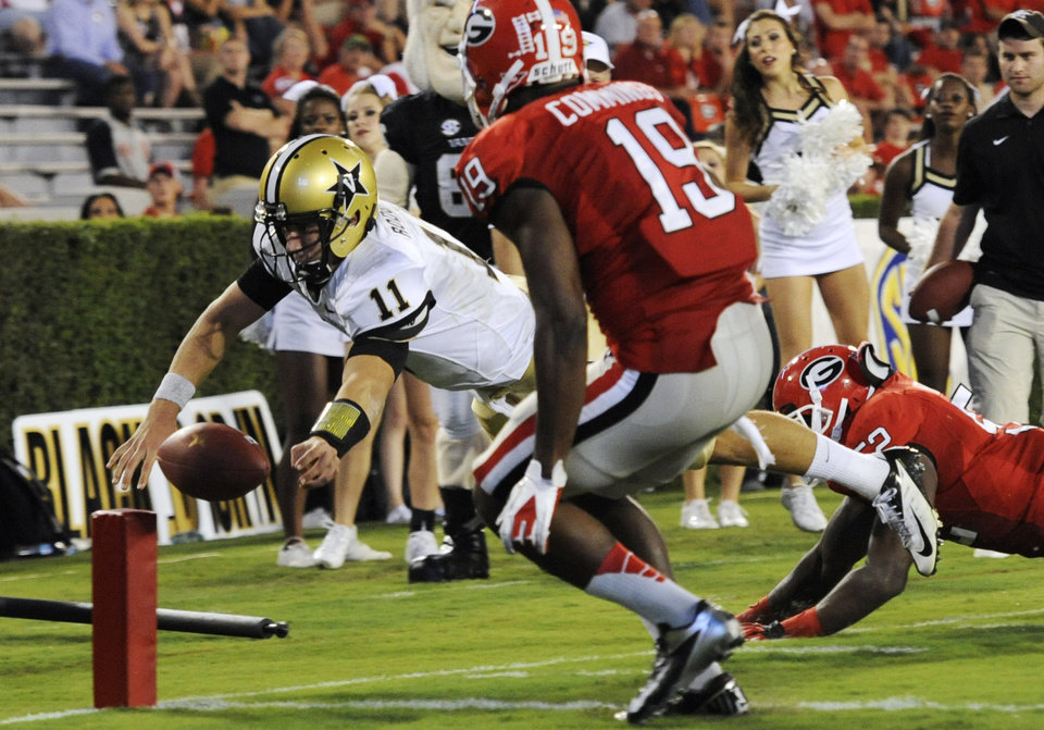 Photo -   Vanderbilt quarterback Jordan Rodgers (11) loses control of the ball while diving into the end zone as Georgia linebacker Amarlo Herrera (52) and cornerback Sanders Commings (19) defend during the fourth quarter of an NCAA college football game on Saturday, Sept. 22, 2012, in Athens, Ga. (AP photo/John Amis)
