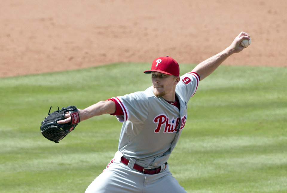Photo - Philadelphia Phillies relief pitcher Jake Diekman (63) works in seventh inning of a baseball game against the Atlanta braves Monday, Sept. 1, 2014, in Atlanta. Diekman combined with three other pitchers for a no hitter. (AP Photo/John Bazemore)