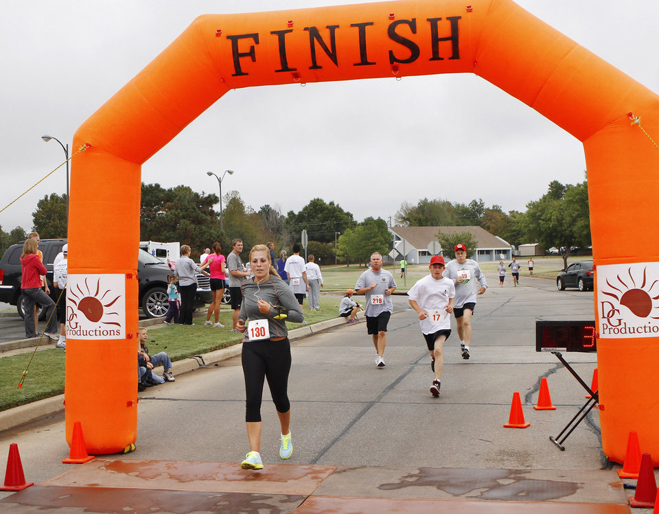 Kelli Kelso, Oklahoma City, crosses the finish line. The Renaissance Run, a 5K run and walk begins at 8:30 a.m. at the Midwest City Community Center. Following the race, runners are invited to enjoy a pancake breakfast at Midwest Regional Medical Center, 2825 Parklawn Drive on Saturday, Sep. 15, 2012, Photo by Jim Beckel, The Oklahoman.