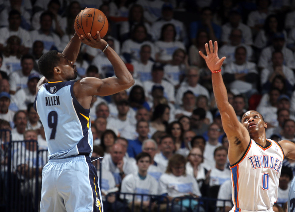 Photo - Memphis' Tony Allen (9) shoots over Oklahoma City's Russell Westbrook (0)