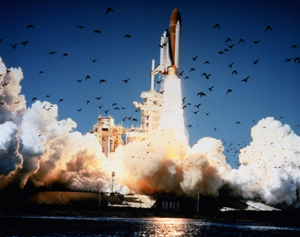 Photo - FILE - In this Jan. 28, 1986 file photo, the space shuttle Challenger lifts off Pad 39B at Kennedy Space Center, Florida.  A whole generation _ including McAuliffe's own students _ has grown up since McAuliffe and six other astronauts perished on live TV on Jan. 28, 1986, a quarter century ago on Friday, Jan. 28, 2011. Now the former schoolchildren who loved her are making sure that people who weren't even born then know about McAuliffe and her dream of going into space. (AP Photo/NASA) ORG XMIT: NY124