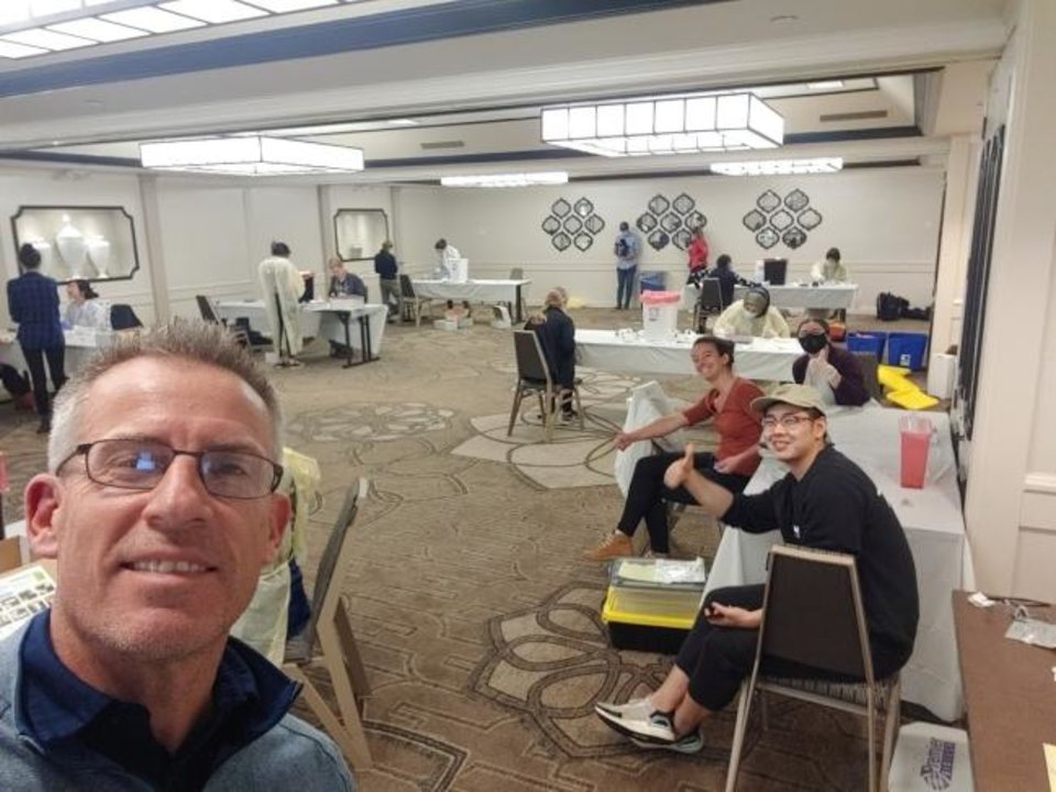 Photo -  Jim Tedrow poses for a photo with volunteers in a makeshift lab in Santa Clara County, California, as they prepare to conduct the first large-scale testing in the U.S. of the prevalence of COVID-19 antibodies in the general population. [Provided]
