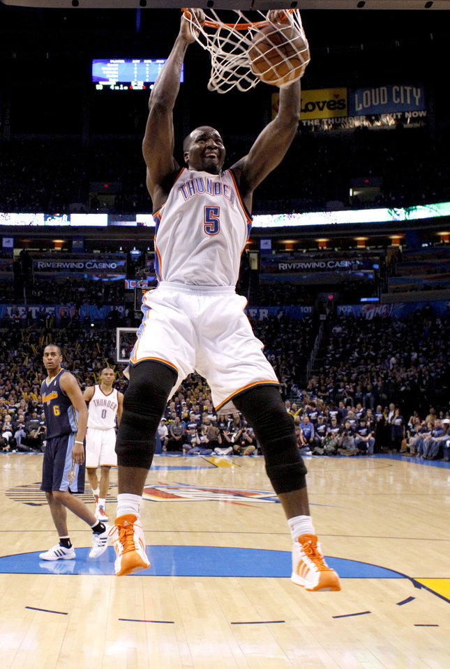 Photo - Oklahoma City's Kendrick Perkins (5) dunks during the NBA basketball game between the Denver Nuggets and the Oklahoma City Thunder in the first round of the NBA playoffs at the Oklahoma City Arena, Wednesday, April 27, 2011. Photo by Sarah Phipps, The Oklahoman