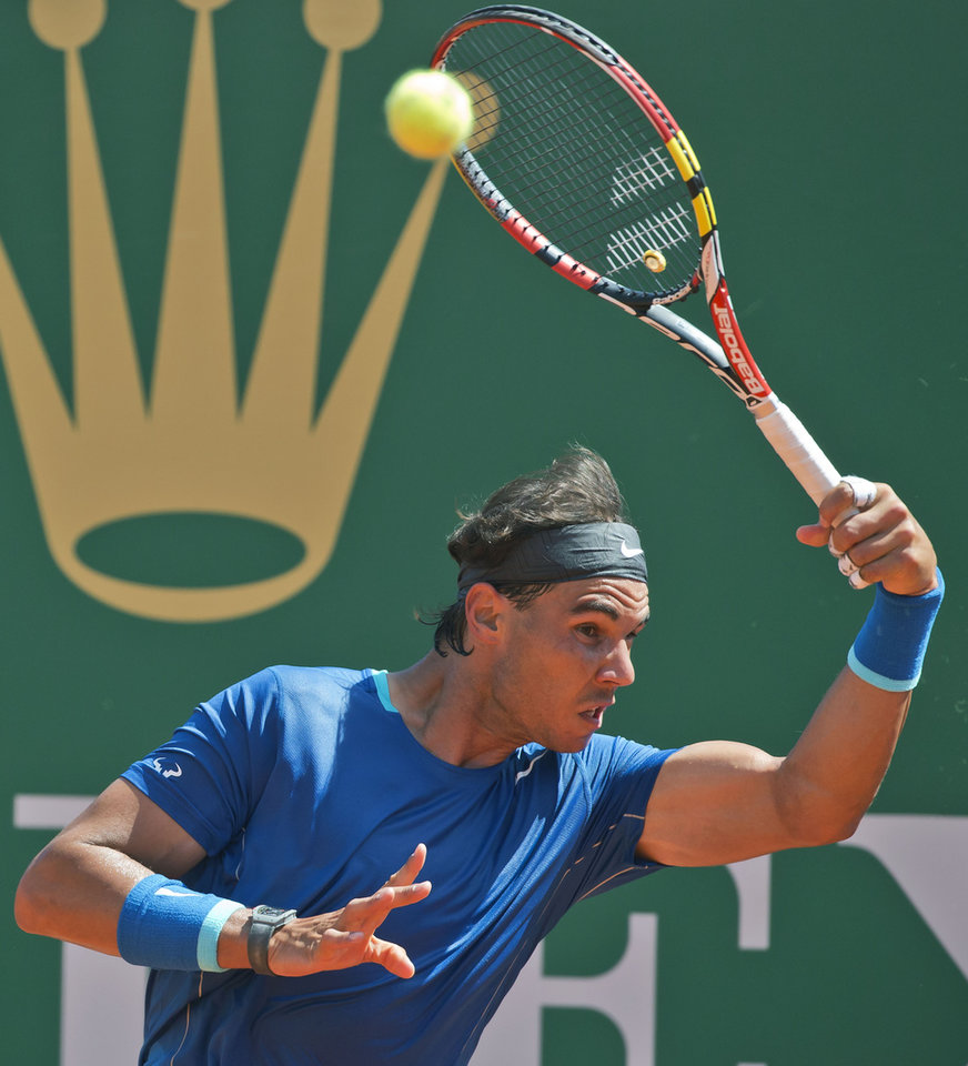 Photo - Rafael Nadal of Spain, returns the ball to Andreas Seppi of Italy, during their third round match of the Monte Carlo Tennis Masters tournament in Monaco, Thursday, April 17, 2014. Nadal won 6-1 6-3. (AP Photo/Michel Euler)