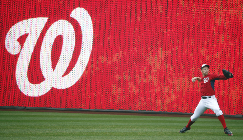 Photo - CORRECTS OPENING DAY TO MARCH 31, NOT APRIL 4 - Washington Nationals starting pitcher Stephen Strasburg (37) warms up before an exhibition baseball game against the Detroit Tigersat Nationals Park Saturday, March 29, 2014, in Washington. Strasburg is scheduled to start on opening day on March 31. (AP Photo/Alex Brandon)