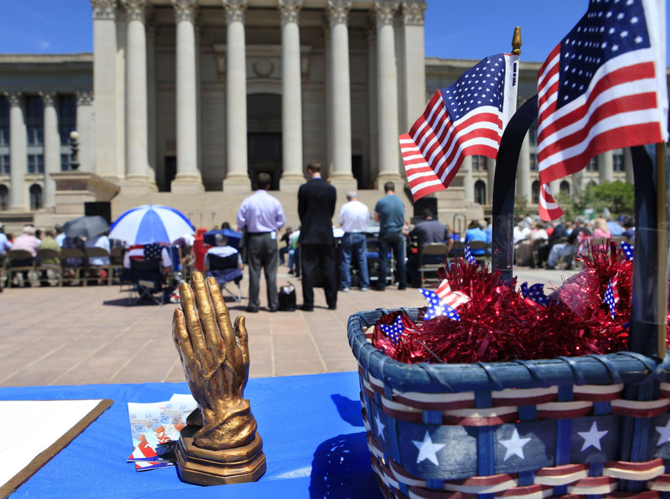 Photo - Nearly 300 people gathered at noon on the south plaza of the state capitol to obseve National Day of Prayer, Thursday, May 6, 2010.  Spiritual music was sung, numerous prayers were offered and several speakers, including Gov.Brad Henry, Lt. Gov. Jari Askins, business representatives, and military and religious  leaders, addressed the crowd.  Photo by Jim Beckel, The Oklahoman