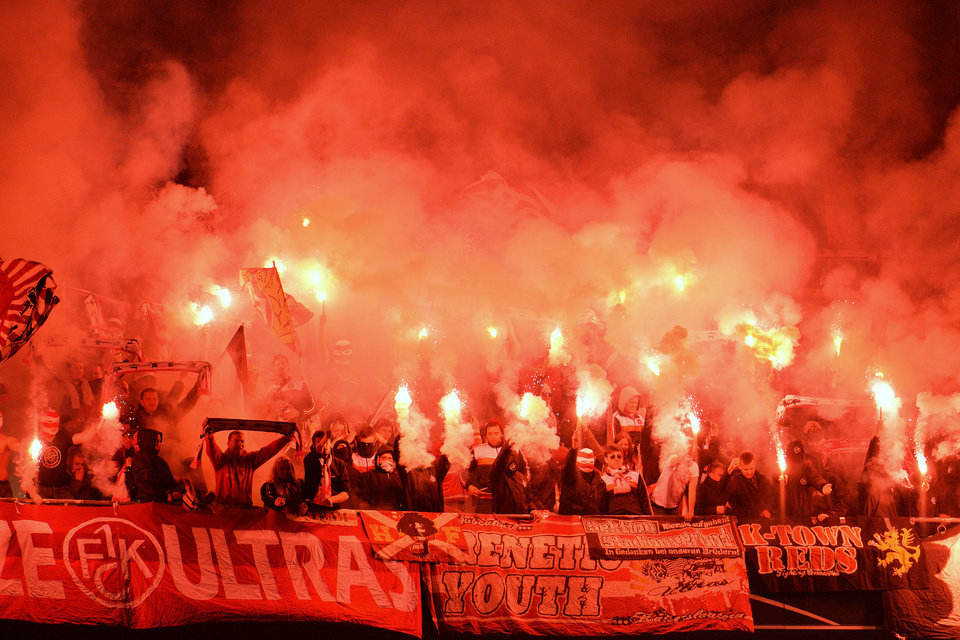 Photo - Kaiserslautern's fans light fireworks during the German soccer cup (DFB Pokal) semifinal match between FC Bayern Munich and FC Kaiserslautern in the Allianz Arena in Munich, Germany, on Wednesday, April 16. 2014. (AP Photo/Kerstin Joensson)