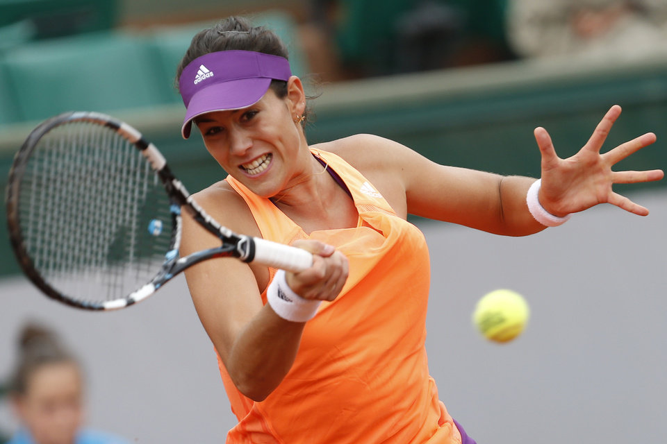 Photo - Spain's Garbine Muguruza returns the ball during the second round match of the French Open tennis tournament against Serena Williams of the U.S. at the Roland Garros stadium, in Paris, France, Wednesday, May 28, 2014. (AP Photo/Darko Vojinovic)