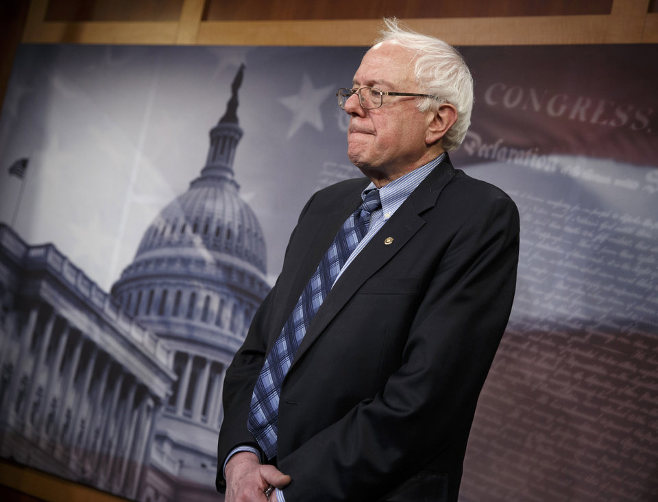 Photo - FILE – This Feb. 20, 2014, file photo shows Senate Veterans Affairs Committee Chairman Sen. Bernie Sanders, I-Vt., standing in defeat after a divided Senate derailed Democratic legislation providing $21 billion for medical, education and job-training benefits for the nation's veterans, as the bill fell victim to election-year disputes over spending and whether to slap sanctions on Iran on Capitol Hill in Washingtons. (AP Photo/J. Scott Applewhite)