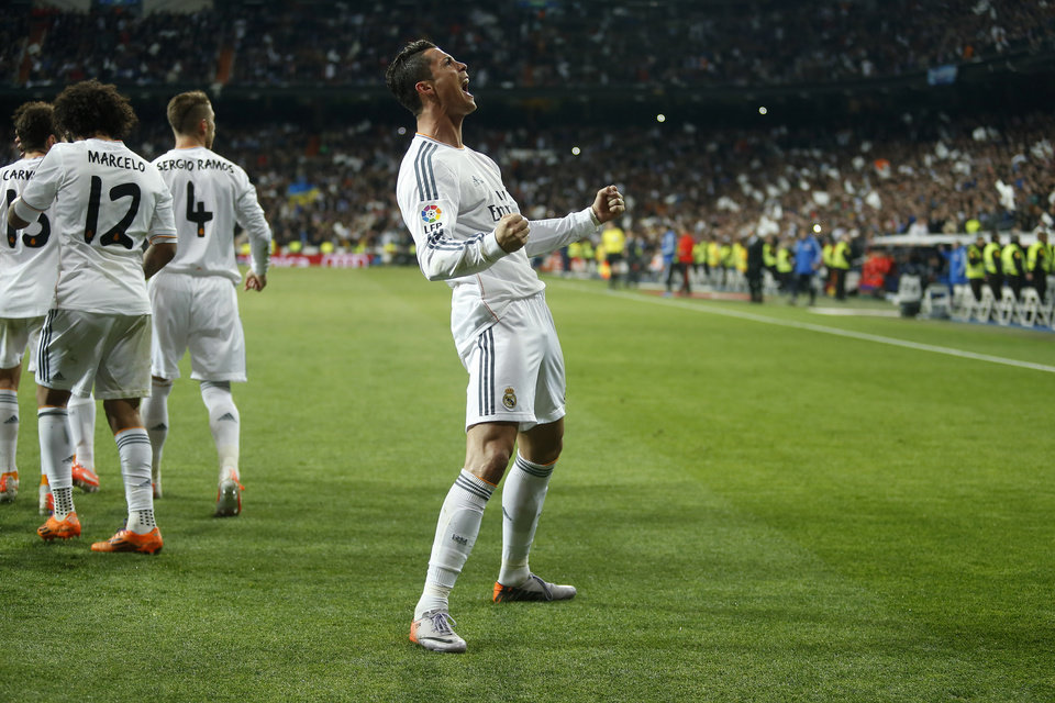 Photo - Real's Cristiano Ronaldo, centre,  celebrates his goal  during a Spanish La Liga soccer match between Real Madrid and FC Barcelona at the Santiago Bernabeu  stadium in Madrid, Spain, Sunday, March 23, 2014. (AP Photo/Andres Kudacki)