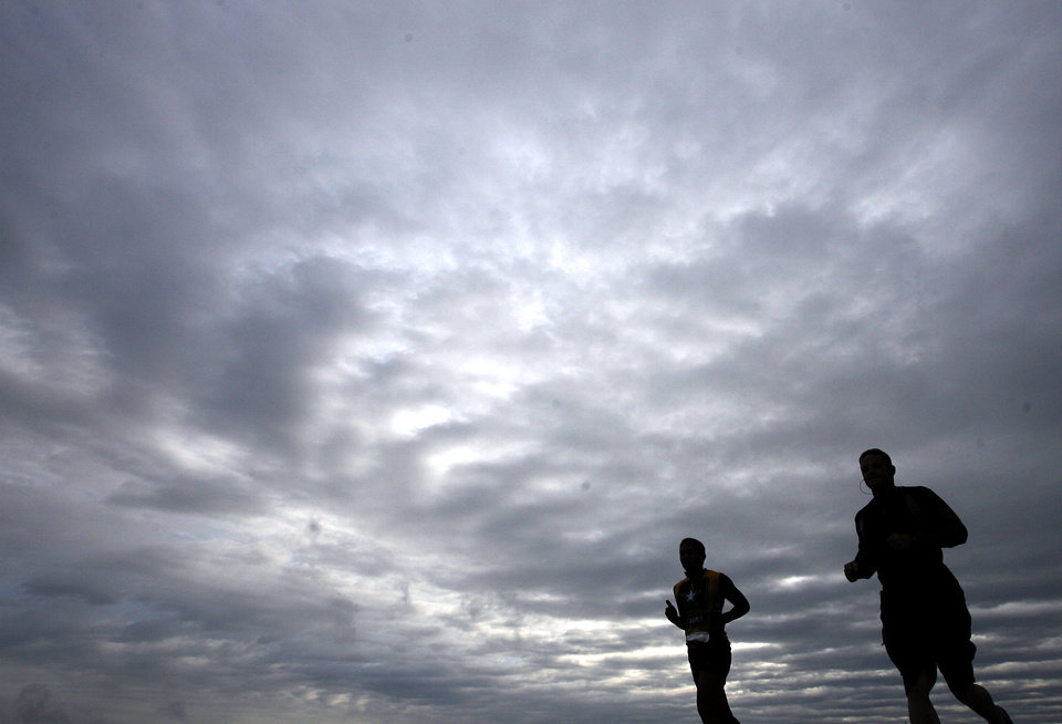Marathon runners run on Britton Road during the 8th annual Oklahoma City Memorial Marathon on Sunday, April 27, 2008, in Oklahoma City, Okla.