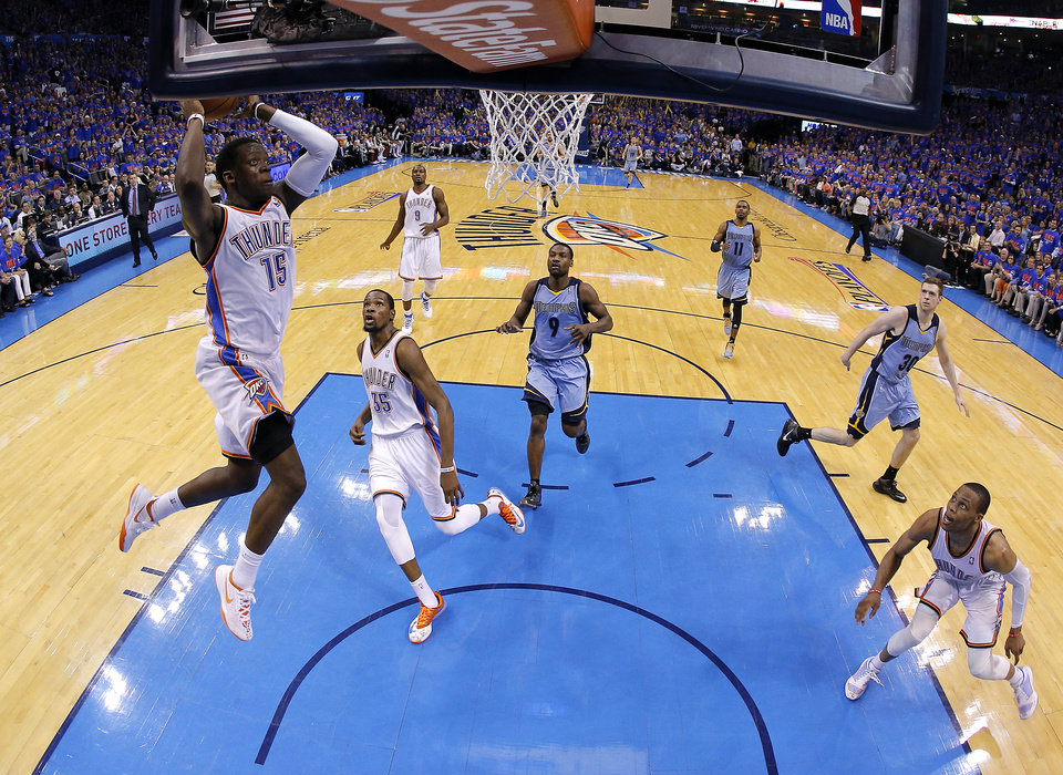 Photo - Oklahoma City's Reggie Jackson (15) goes up for a dunk during Game 7 in the first round of the NBA playoffs between the Oklahoma City Thunder and the Memphis Grizzlies at Chesapeake Energy Arena in Oklahoma City, Saturday, May 3, 2014. Photo by Sarah Phipps, The Oklahoman