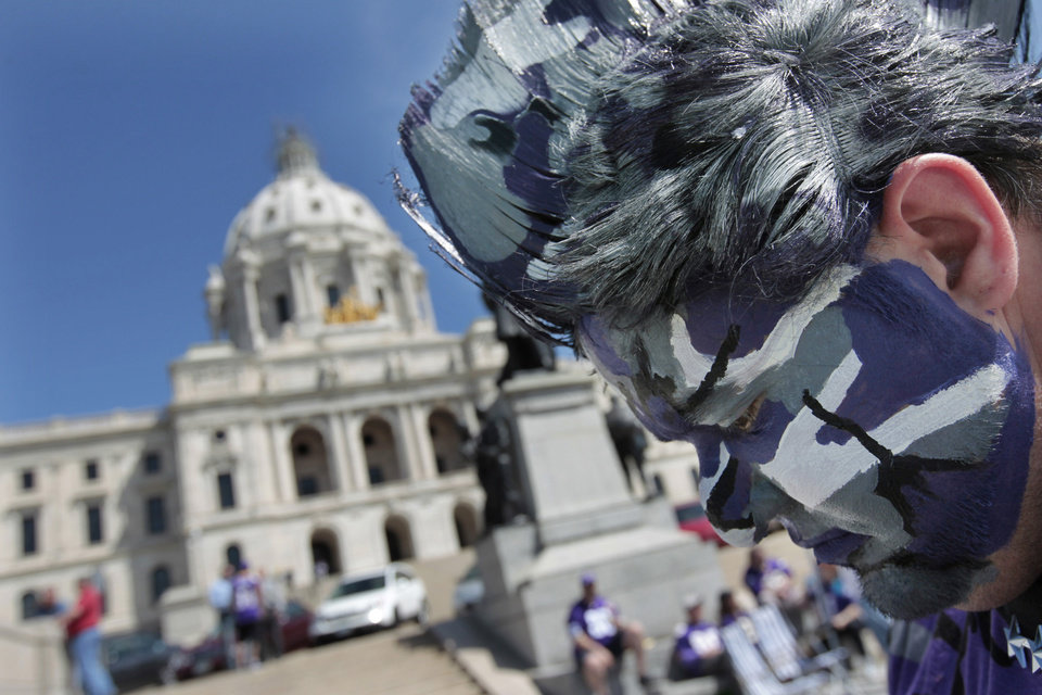 Photo -   Minnesota Vikings fan Josh Lynch, of Red Wing, Minn., attends a rally at the state Capitol in support of a new stadium for the NFL football team, Monday, May 7, 2012, in St. Paul, Minn. Supporters of a new Vikings stadium pleaded for votes in the Minnesota House on Monday, calling it their