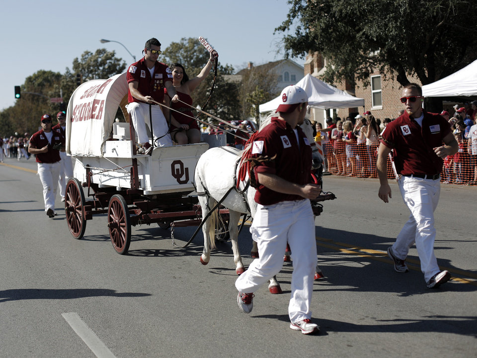 The OU Ruf Neks drive the Sooner Schooner during the University of Oklahoma Homecoming Parade in Norman, Okla., Saturday, Oct. 20, 2012.  Photo by Garett Fisbeck, The Oklahoman