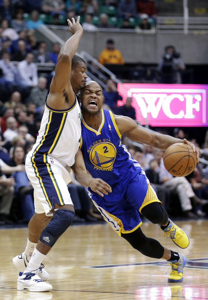 Photo - Utah Jazz's Earl Watson, left, defends Golden State Warriors' Jarrett Jack (2) in the first quarter during an NBA basketball game Tuesday, Feb. 19, 2013, in Salt Lake City. (AP Photo/Rick Bowmer)