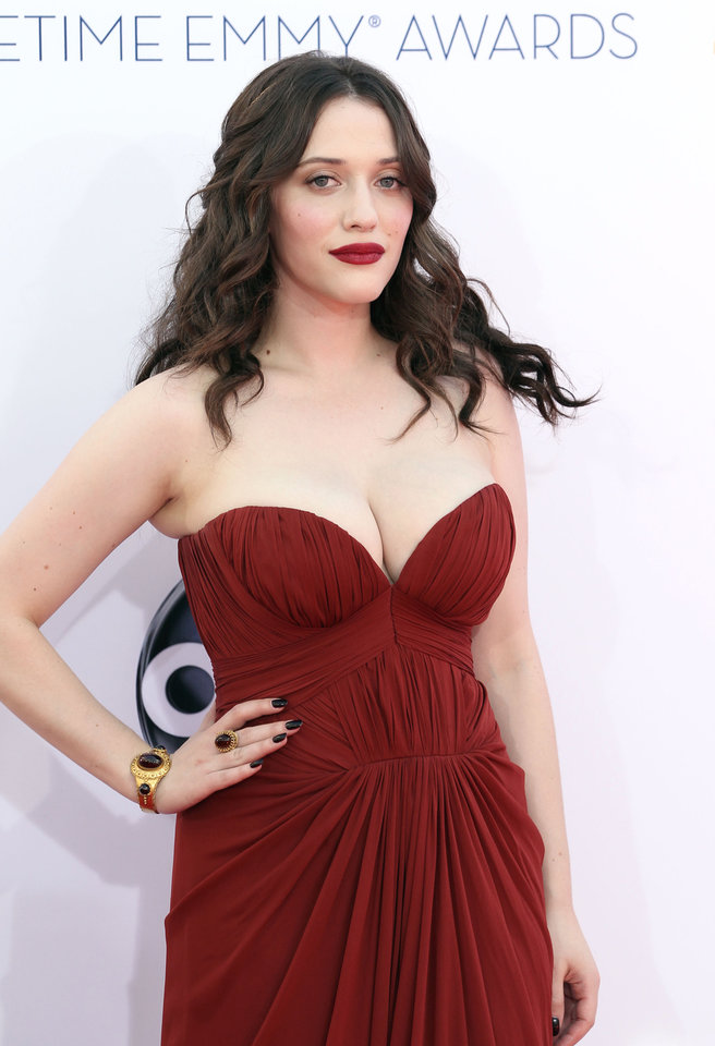 Photo -   Kat Dennings arrives at the 64th Primetime Emmy Awards at the Nokia Theatre on Sunday, Sept. 23, 2012, in Los Angeles. (Photo by Matt Sayles/Invision/AP)