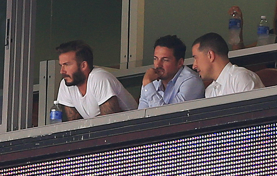 Photo - David Beckham, left, watches the international friendly soccer match between England and Honduras in Miami Gardens, Fla., on Saturday, June 7, 2014. (AP Photo/El Nuevo Herald, Pedro Portal) MAGS OUT