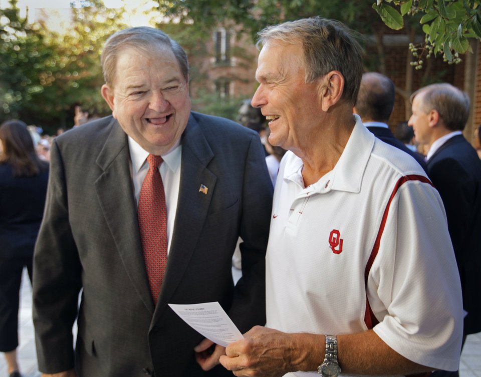 Photo - Ring Ceremony honoree Bob Barry (left) talks with his radio announcing partner Merv Johnson before a ceremony at which graduating seniors at the University of Oklahoma receive their class rings on Friday, October 15, 2010, in Norman, Okla.    Photo by Steve Sisney, The Oklahoman