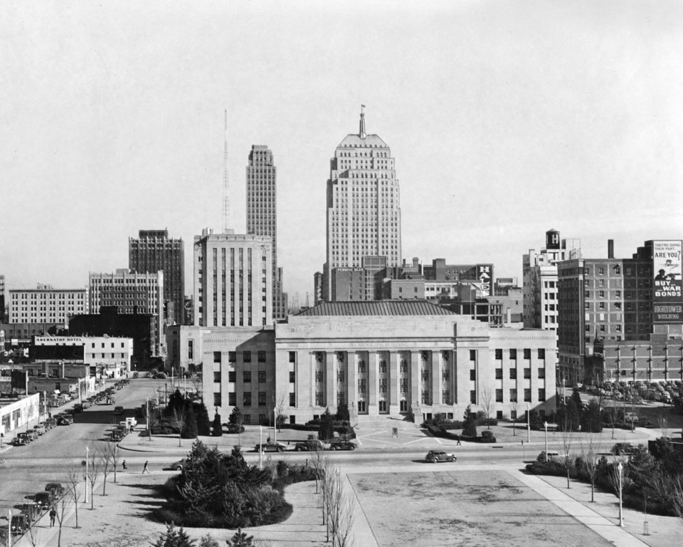 OKLAHOMA CITY / SKY LINE / OKLAHOMA:  This is a view of the skyline of Oklahoma City as seen through the camera's lens from the roof of the Municipal auditorium.  In the foreground are the county building and in the front of it the Municipal building, with the First National bank building and Ramsey tower in the background.  These buildings laid their foundations on the wealth of oil, livestock, farming and other businesses that have built the city into one of the leaders of the great southwest.  Photo undated and published 01/02/1943 in The Daily Oklahoman and 06/01/1947 in The Daily Oklahoman.
