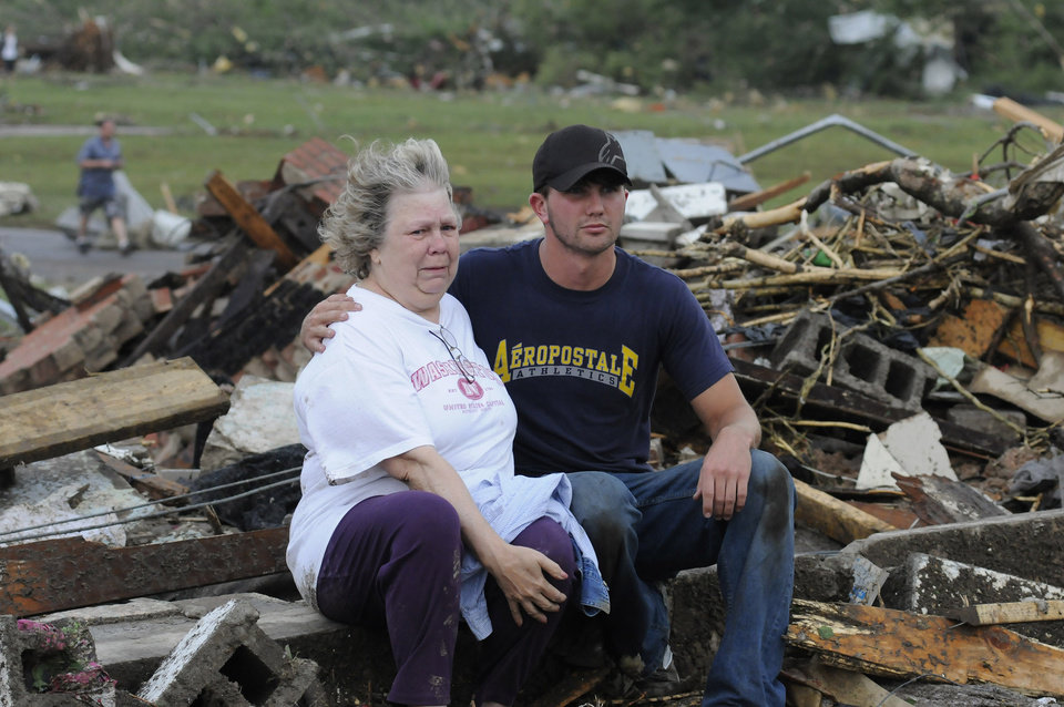 Photo - Judy Cook who lost her Masters Drive home is conforted by Chase Spradlin in Concord, Ala., Wednesday April 27, 2011. What appeared to be a tornado ripped through parts of Concord, Ala., outside llate Wednesday. The damage in the area is extensive with homes and businesses destroyed and people injured.  (AP Photo/Birmingham News, Jeff Roberts)