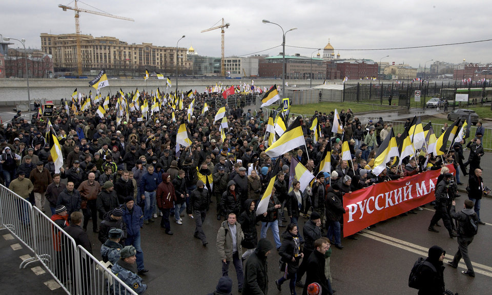"Ultra nationalist demonstrators and activists shout anti-government slogans, with banner reading "" Russian March"", as they march to mark National Unity Day, in Moscow, on Sunday, Nov. 4, 2012. The march took place on Unity Day, a national holiday established in 2005 to replace commemorations of Bolshevik Revolution. (AP Photo/Ivan Sekretarev)"