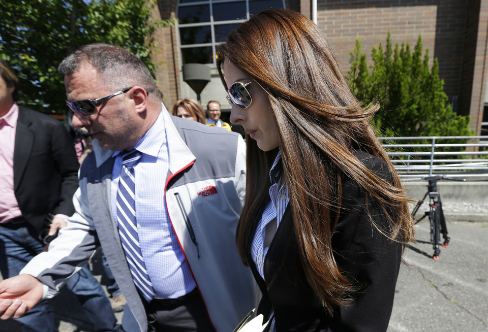 Photo - Kerri Kasem, right, the daughter of ailing radio personality Casey Kasem, leaves the Kitsap County Courthouse, Friday, May 30, 2014 in Port Orchard, Wash. Kasem was in court as part of an ongoing dispute with her stepmother Jean Kasem, over whether her father is receiving adequate medical care. Casey and Jean Kasem have been staying with family friends in Washington state. (AP Photo/Ted S. Warren)