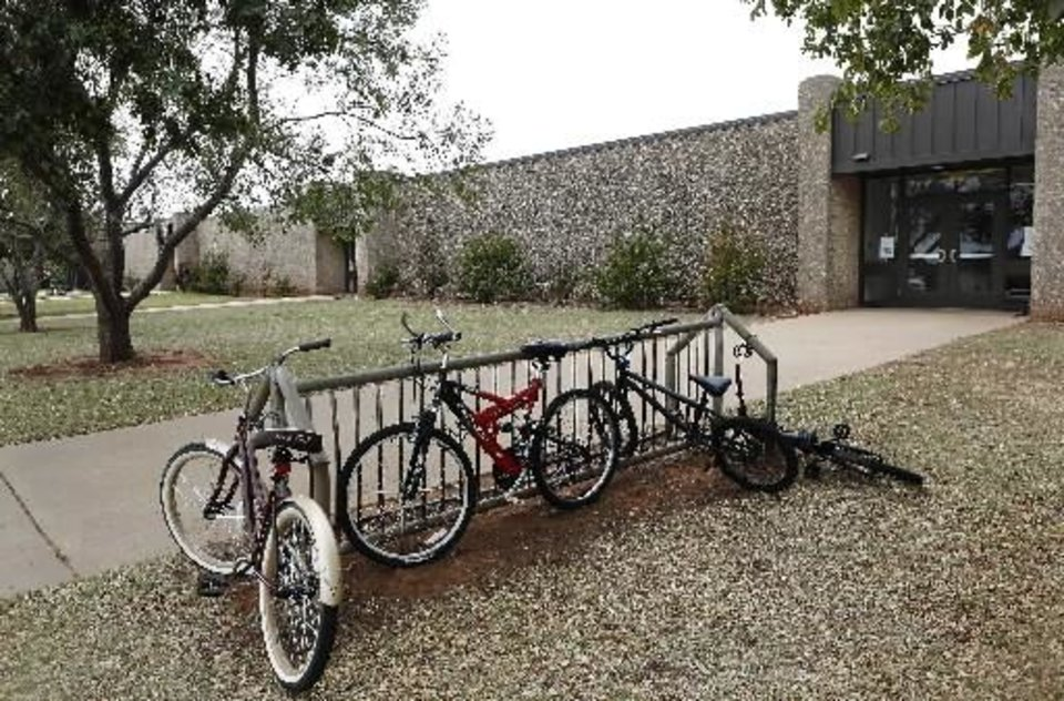Photo - A few bicycles remain in a bike rack in front of Stillwater Junior High School, where student Cade Poulos, 13, died this morning, Wednesday, Sep. 26, 2012, from a self-inflicted gunshot wound to the head. Students were evacuated from the school after the incident. Photo by Jim Beckel, The Oklahoman.