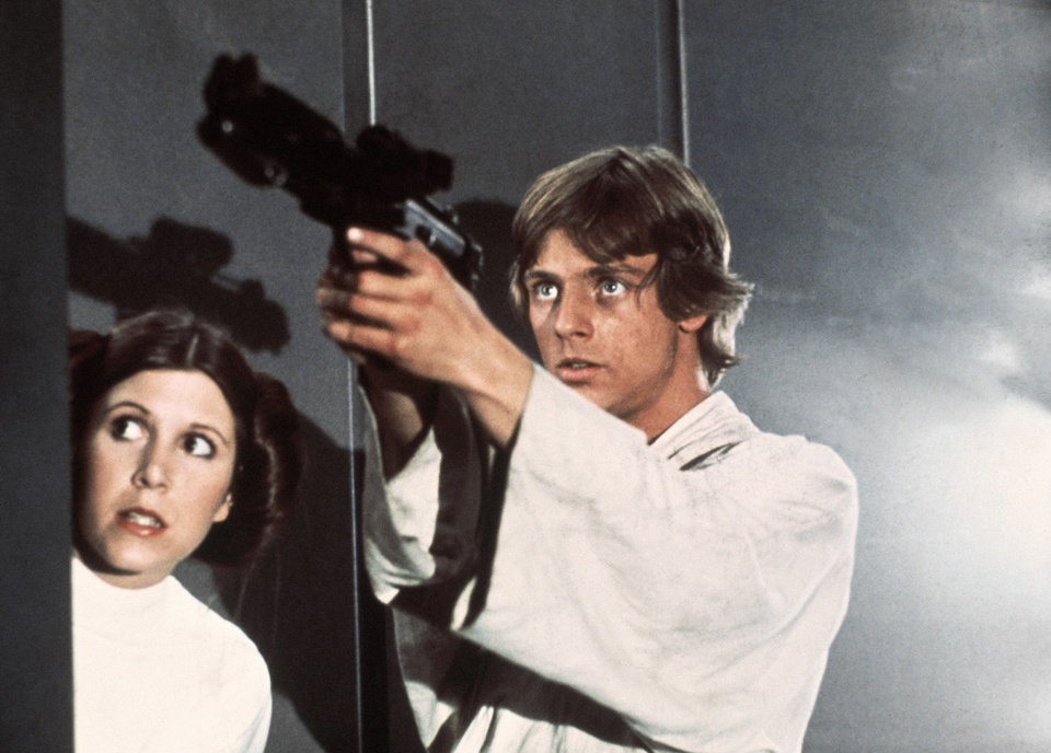"In this image provided by 20th Century-Fox Film Corporation, a scene from ""Star Wars"" movie released by 20th Century-Fox in 1977.  From left are: Carrie Fisher and Mark Hamill. (AP Photo/20th Century-Fox Film Corporation)"