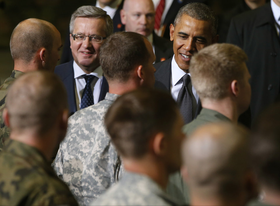 Photo - U.S. President Barack Obama and Poland's President Bronislaw Komorowski meet U.S. and Polish troops at an event featuring four F-16 fighter jets, two American and two Polish, as part of multinational military exercises, in Warsaw, Poland, Tuesday, June 3, 2014. (AP Photo/Charles Dharapak)