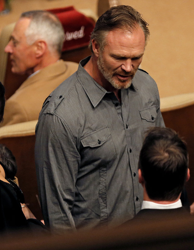 Photo - Brian Bosworth talks to other attendees during the funeral for former University of Oklahoma football player Steve Davis at the First Baptist Church on Monday, March 25, 2013, in Tulsa, Okla. Davis died in a plane crash last week in Indiana. Photo by Chris Landsberger, The Oklahoman