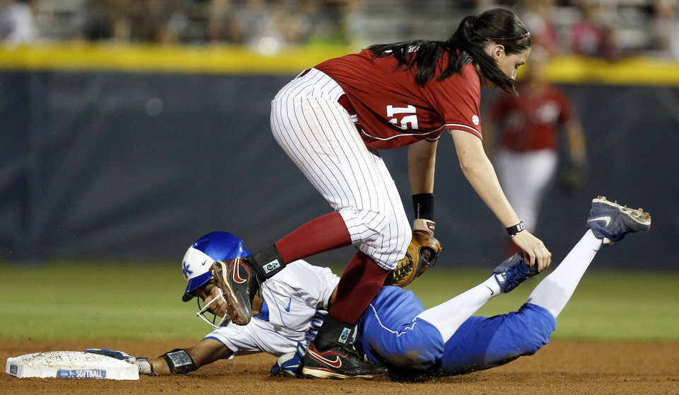 Photo - Kentucky's Sylver Samuel (2) is tagged out trying to steal 2nd base by Alabama's Danae Hays (15) in the 6th inning during Game 6 of the Women's College World Series softball tournament between Alabama and Kentucky at ASA Hall of Fame Stadium in Oklahoma City, Friday, May 30, 2014. Alabama won, 2-0. Photo by Nate Billings, The Oklahoman