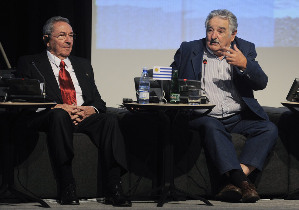 Uruguay's President Jose Mujica, right, speaks next to Cuba's President Raul Castro, left, during the CELAC-EU economic summit in Santiago, Chile, Sunday, Jan. 27, 2013. Leaders from the European Union, Latin America and the Caribbean are in the Chilean capital for the 60-nation, two day economic summit.(AP Photo/CELAC-EU)