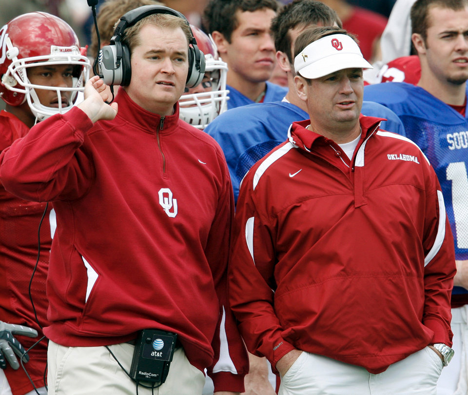 OU has promoted quarterbacks coach Josh Heupel, left, to co-offensive coordinator. Heupel will handle play-calling duties, starting with the Fiesta Bowl on Jan. 1. OKLAHOMAN ARCHIVE PHOTO