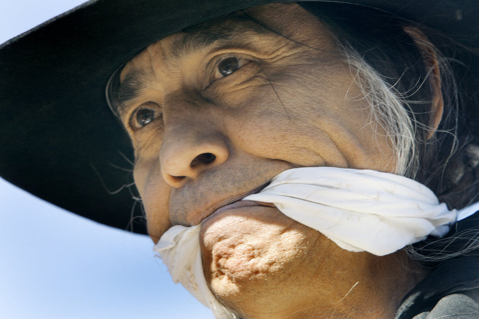 Photo - Richard Whitman of OKC portrays Mr. Indian Territory Friday, Nov. 16, 2007 during part of the Oklahoma Indians Survival Walk and Remembrance Ceremony near the state Capitol. BY JACONNA AGUIRRE/THE OKLAHOMAN.