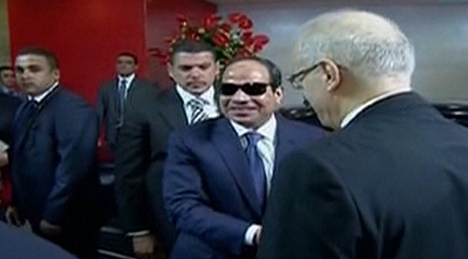Photo - This image made from Egyptian State Television shows Abdel-Fattah el-Sissi arriving at the  Supreme Constitutional Court in Cairo, Egypt, Sunday, June 8, 2014, to be sworn in as president. El-Sissi's inauguration Sunday comes less than a year after the 59-year-old career infantry officer ousted the country's first freely elected president, the Islamist Mohammed Morsi, following days of mass protests by Egyptians demanding he step down. (AP Photo/Egyptian State Television)