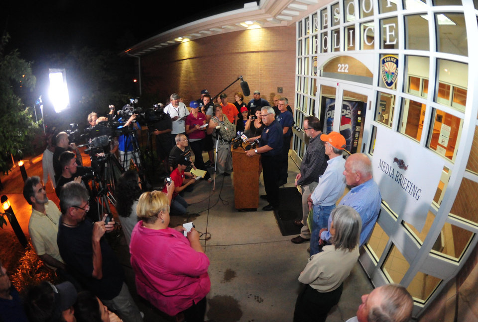 Photo - Prescott Ariz. Fire Chief Dan Fraijo, center at podium, gives a news conference in Prescott, Ariz. confirming that 19 members of the City of Prescott's Granite Mountain Hotshot team died while fighting the Yarnell Hill Fire Sunday, June 30, 2013. (AP Photo/The Daily Courier, Les Stukenberg)