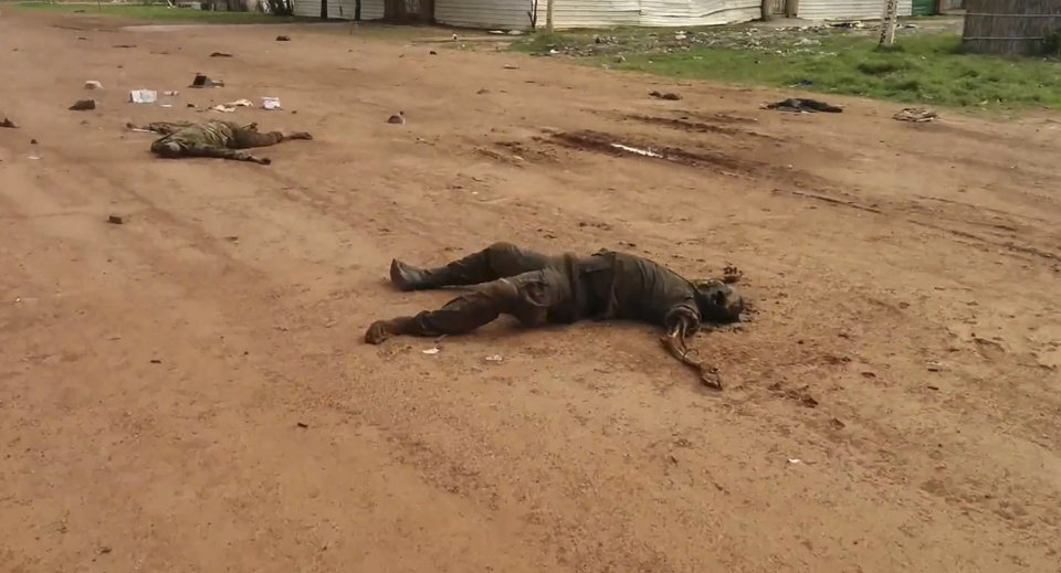 Photo - EDS NOTE GRAPHIC CONTENT In this image taken from video dead bodies lie on the road near Bentiu South Sudan on Sunday April 20, 2014. U.N.'s top humanitarian official in South Sudan Toby Lanzer  told The Associated Press in a phone interview Tuesday April 23, 2014, that the ethnically targeted killings are