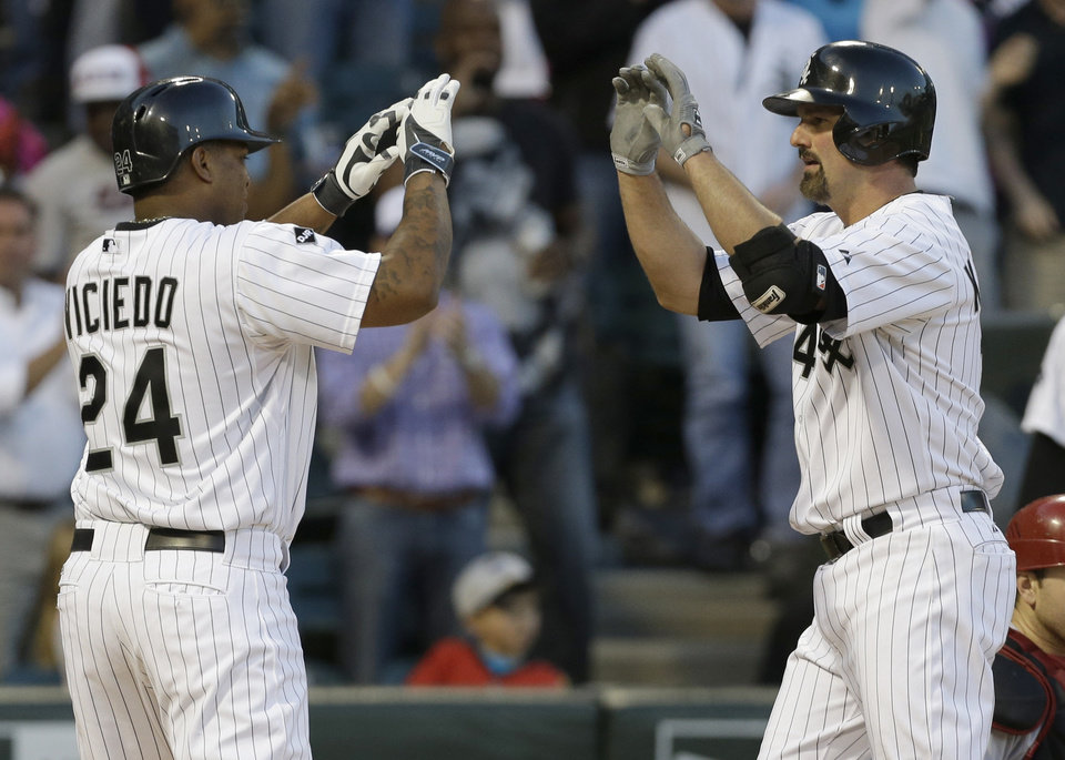 Photo - Chicago White Sox's Paul Konerko, right, celebrates with teammate Dayan Viciedo after hitting a two-run home run against the Arizona Diamondbacks during the fifth inning of an interleague baseball game in Chicago, Saturday, May 10, 2014. (AP Photo/Nam Y. Huh)