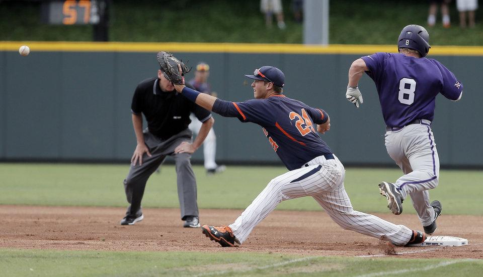 Photo - Pepperdine first baseman Brad Anderson (24) reaches for the throw as TCU's Boomer White (8) attempts to reach first during the first inning of an NCAA college baseball tournament super regional game in Fort Worth, Texas, Monday, June 9, 2014. White was called out on the play. (AP Photo/Brandon Wade)