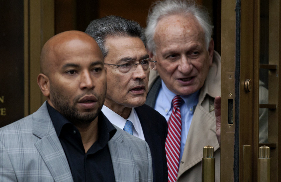 Photo -   Rajat Gupta, center, leaves federal court in New York on Wednesday, Oct. 24, 2012 after the former Goldman Sachs and Procter & Gamble Co. board member was sentenced Wednesday to 2 years in prison for feeding inside information about board dealings with a billionaire hedge fund owner who was his friend. At right is Gupta's attorney, Gary Naftalis. (AP Photo/Craig Ruttle)