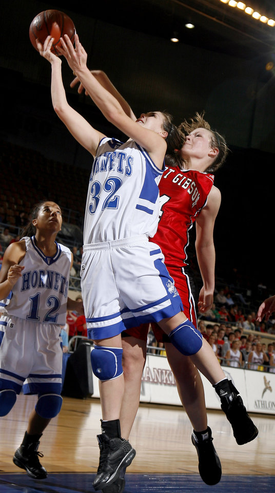 Photo - Vinita's Caitlyn Spurgeon (32) and Ft. Gibson's Nana Wallace (4) fight for a rebound during the girls 4A semifinal between Fort Gibson and Vinita at the State Fair Arena, Friday, March 13, 2009, in Oklahoma City. PHOTO BY SARAH PHIPPS, THE OKLAHOMAN