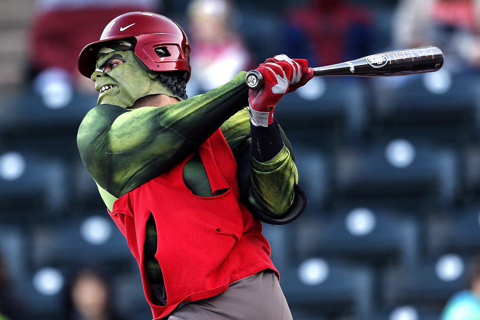 Above: Anthony Hermelyn, dressed as Hulk, swings Thursday during the University of Oklahoma baseball�s ALS Awareness Halloween Game at L. Dale Mitchell Park in Norman.  Photo by Sarah Phipps,  The Oklahoman