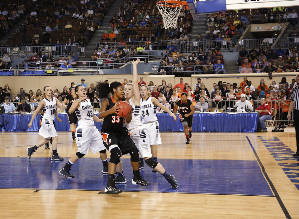 Photo - Preston guard Ki-Essence Shields drives toward the basket during the Class 2A Girls State Championship game between Preston and Cordell at Jim Norick Arena at State Fair Park  on Saturday, Mar. 15, 2014.  Preston won,  45-41. Photo by Jim Beckel, The Oklahoman