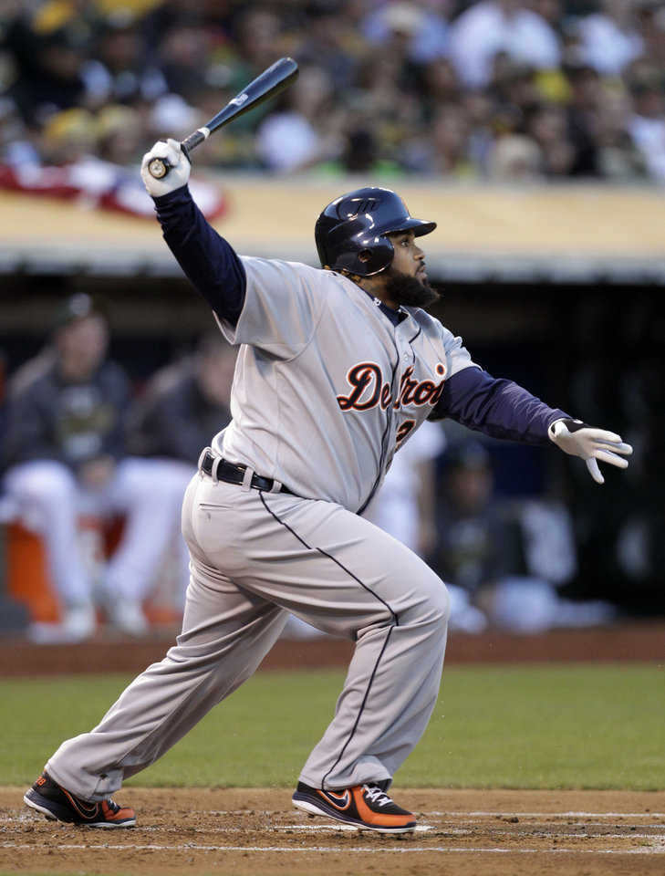 Detroit Tigers' Prince Fielder watches a long fly ball which Oakland Athletics' Coco Crisp caught for the out in the second inning of Game 3 of an American League division baseball series in Oakland, Calif., Tuesday, Oct. 9, 2012. (AP Photo/Ben Margot)