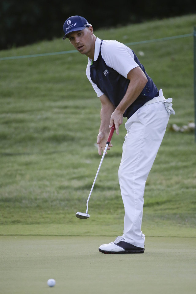 Photo - Ben Crane putts on the 6th green during the first round of the St. Jude Classic golf tournament Thursday, June 5, 2014, in Memphis, Tenn. Crane shot a par on the hole and ended the day at the top of the leader board at 7-under 63. (AP Photo/Mark Humphrey)