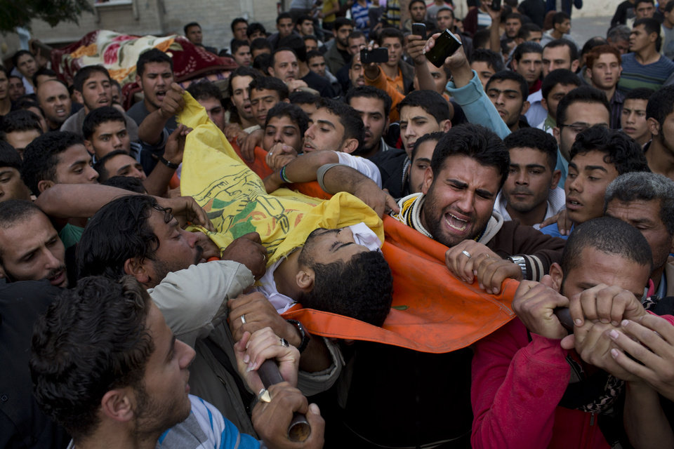 Photo -   Palestinians carry the body of Mohammed Salman during his funeral in Beit Lahia, north Gaza, Friday, Nov. 16, 2012. According to relatives, Tahrer Salman and Mohammed Salman and were killed after an Israeli airstrike hit the yard of their house. (AP Photo/Bernat Armangue)
