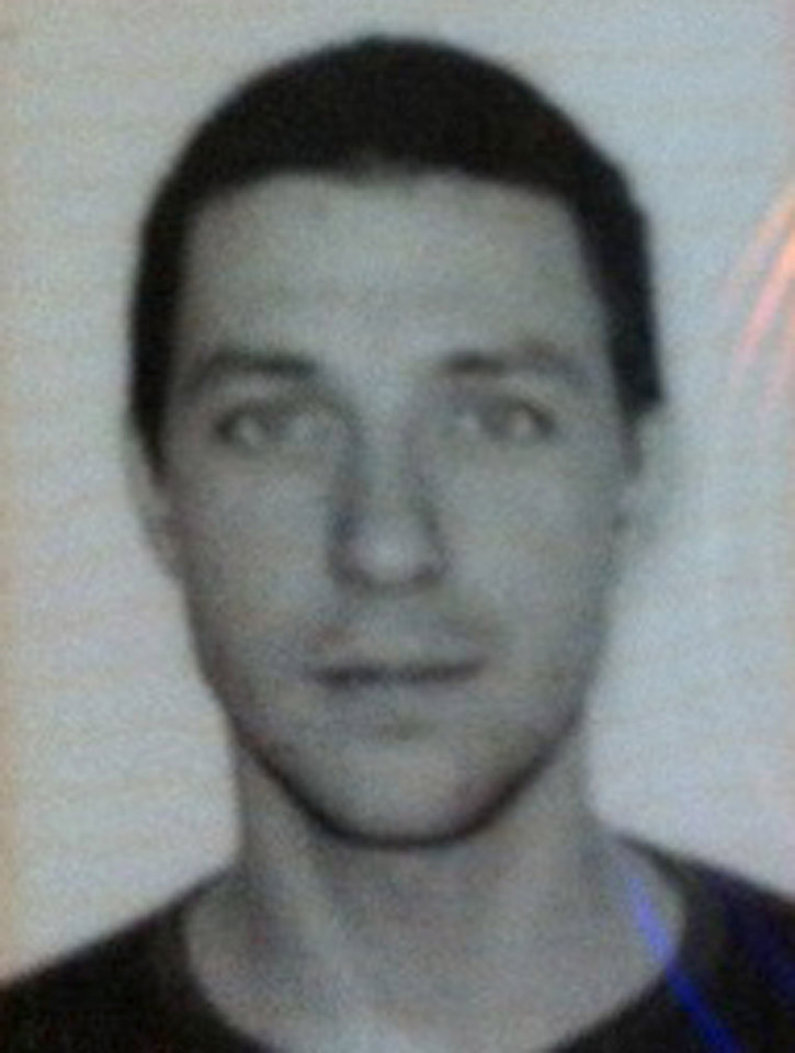 Photo -   This image provided by Chile's ONEMI or regional emergency office, shows the passport photo of Dmitry Sivenkov, 32, of Russia, one of three European tourists hiking around the Villarica volcano in Chile's central valley who has not been heard from since Wednesday evening, Nov. 7, 2012 . Teams led by special police and the Andean Aid Team have been searching the area for Sivenkov, and fellow hikers, Gillhem Bellon, 25, of France; and Luca Ogliengo, 25, of Italy. (AP Photo/Chile's ONEMI)